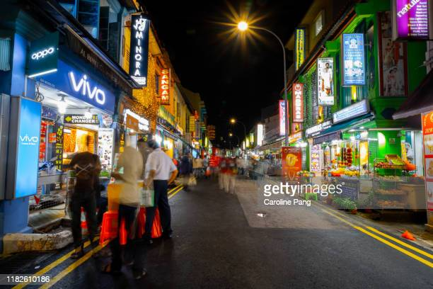 stretch of colourful shophouses in little india, singapore. - caroline pang stock pictures, royalty-free photos & images