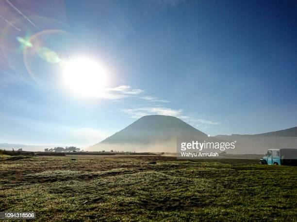stretch of grass and sunlight on the top of mount bromo - bromo tengger semeru national park stock pictures, royalty-free photos & images