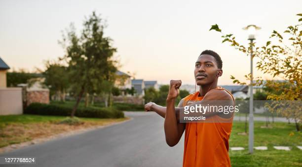 stretch well if you want your muscles to work properly - warming up stock pictures, royalty-free photos & images