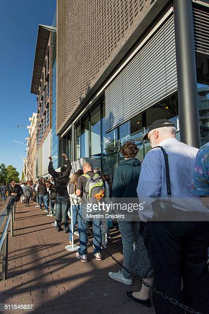 stretching after long wait in museum queue - anne frank house stock pictures, royalty-free photos & images