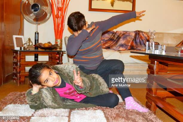 stretching arms and a victory sign - cute pakistani boys stock photos and pictures