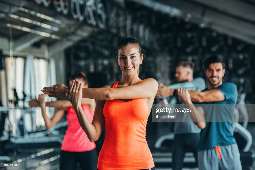 Stretching at the gym : Stock Photo