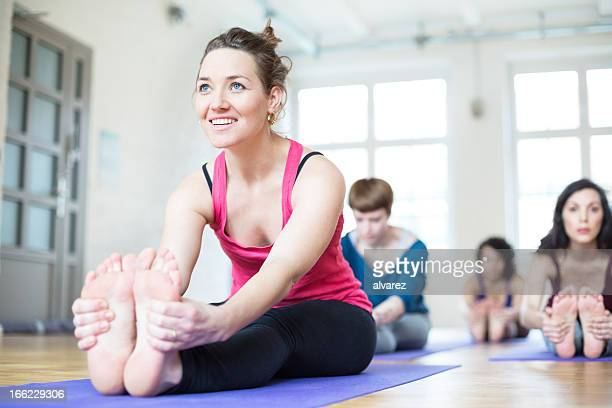 Stretching at yoga class