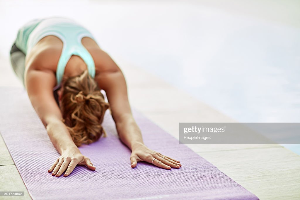 Stretching away the stress : Stock Photo