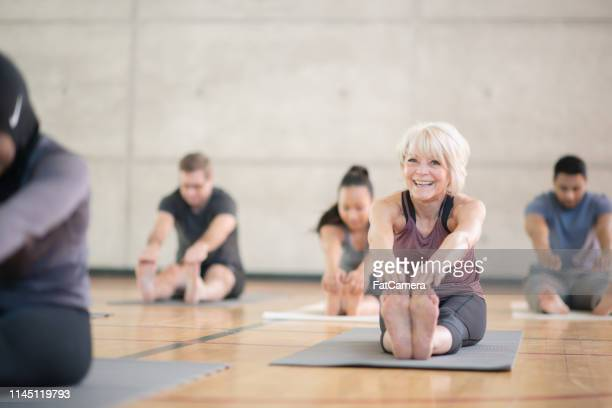 stretching class - yoga studio stock pictures, royalty-free photos & images