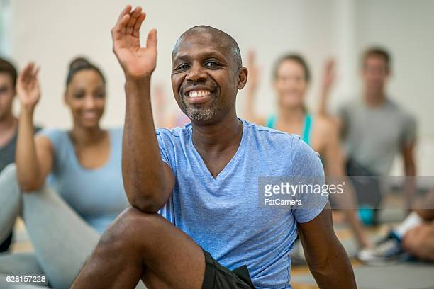 Stretching during a Yoga Class