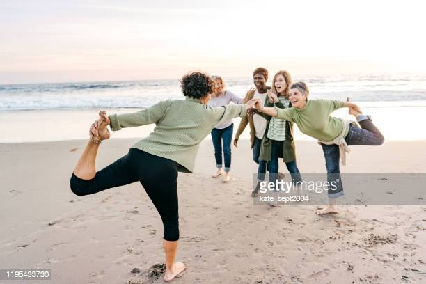 stretching exercises after 60 - kate green stock pictures, royalty-free photos & images