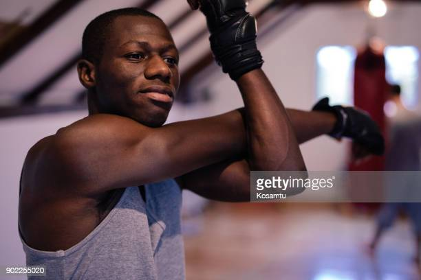 stretching exercises on boxing training - black male feet stock photos and pictures