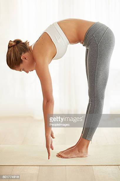 stretching for better health - bending over stock pictures, royalty-free photos & images