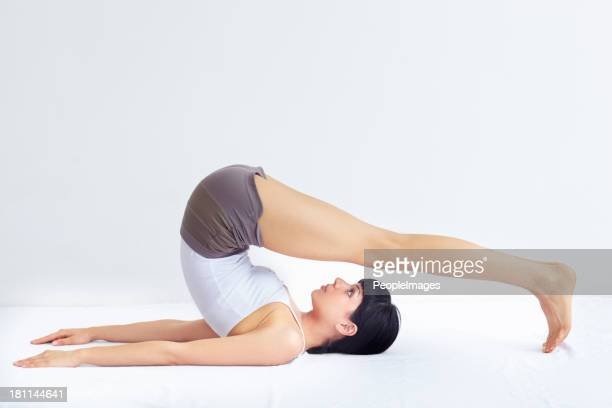 stretching her lower back - lower back stock pictures, royalty-free photos & images