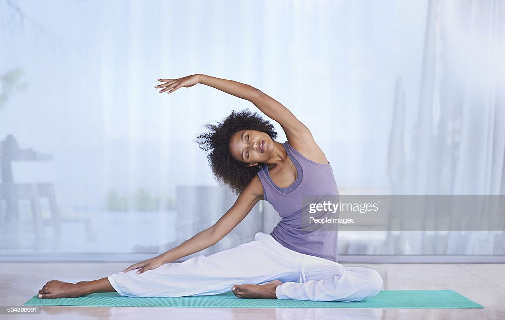 Stretching her sides : Stock Photo