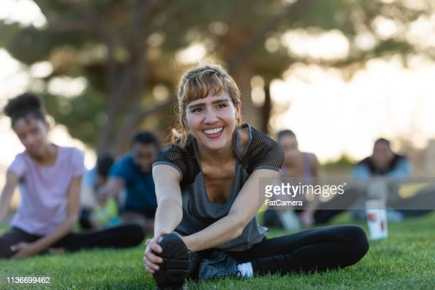 Stretching in the park with friends