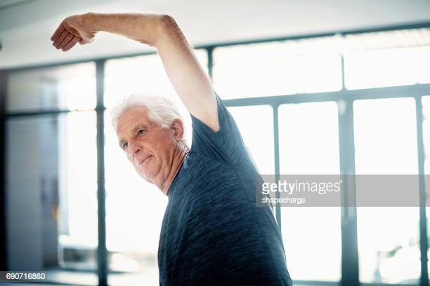 stretching is a good way to slowly build strength - good posture stock pictures, royalty-free photos & images