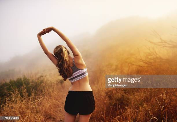 stretching is essential - bra top stock pictures, royalty-free photos & images