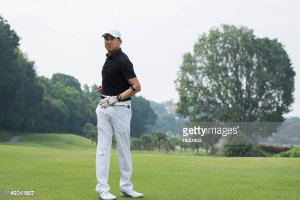 stretching is key to stay loose during golf round - warm up exercise stock pictures, royalty-free photos & images