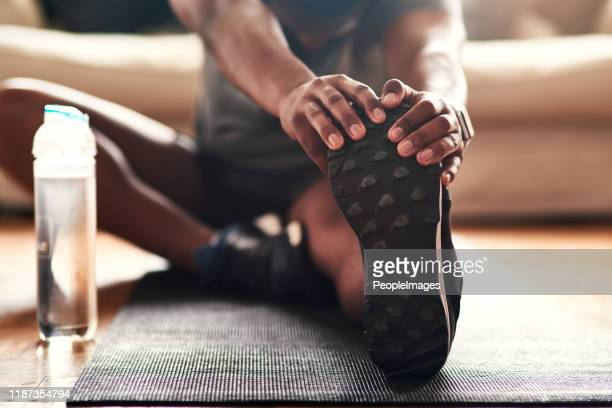 stretching is something you should be doing every day - domestic life stock pictures, royalty-free photos & images