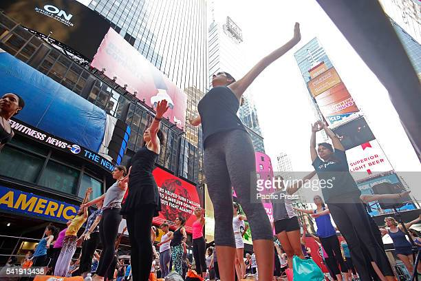 Stretching The 14th annual Solstice in Times Square Mind Over Madness Yoga marked 2016's longest day with nearly a dozen free yoga lessons attended...