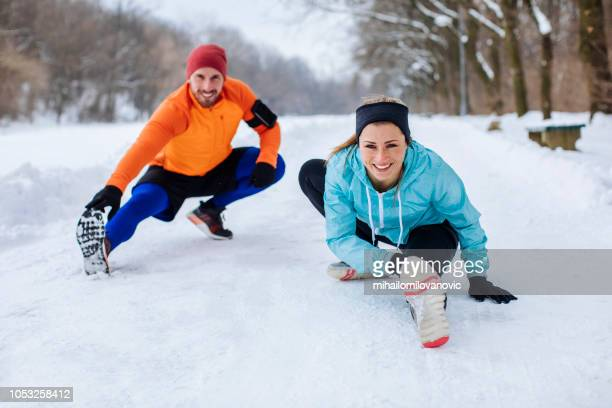 two runners snowy park doing some
