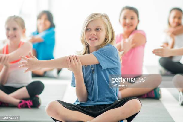 stretching together in  the gym - physical education stock photos and pictures