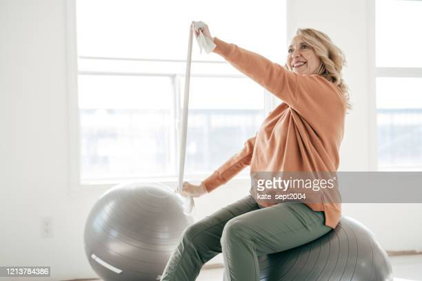 stretching your body after 60 - trainold stock pictures, royalty-free photos & images