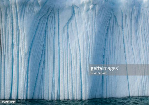 striated face of grounded iceberg - baffin island stock pictures, royalty-free photos & images