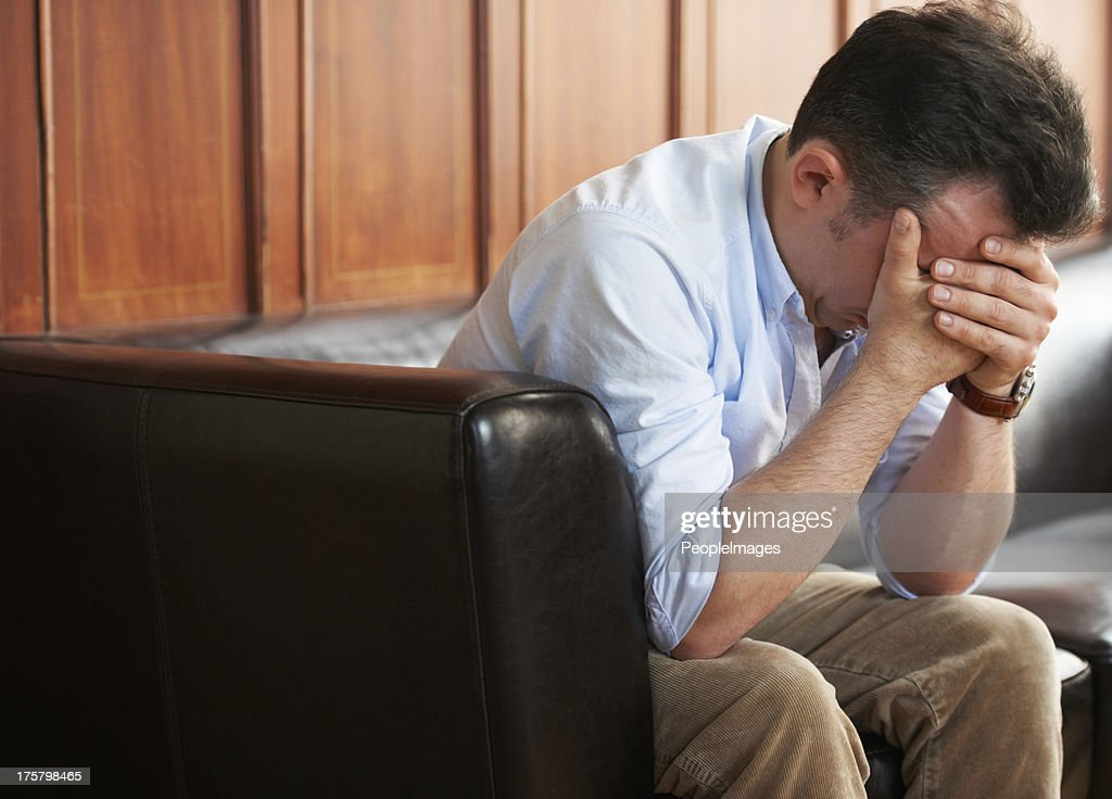 Stricken with grief : Stock Photo
