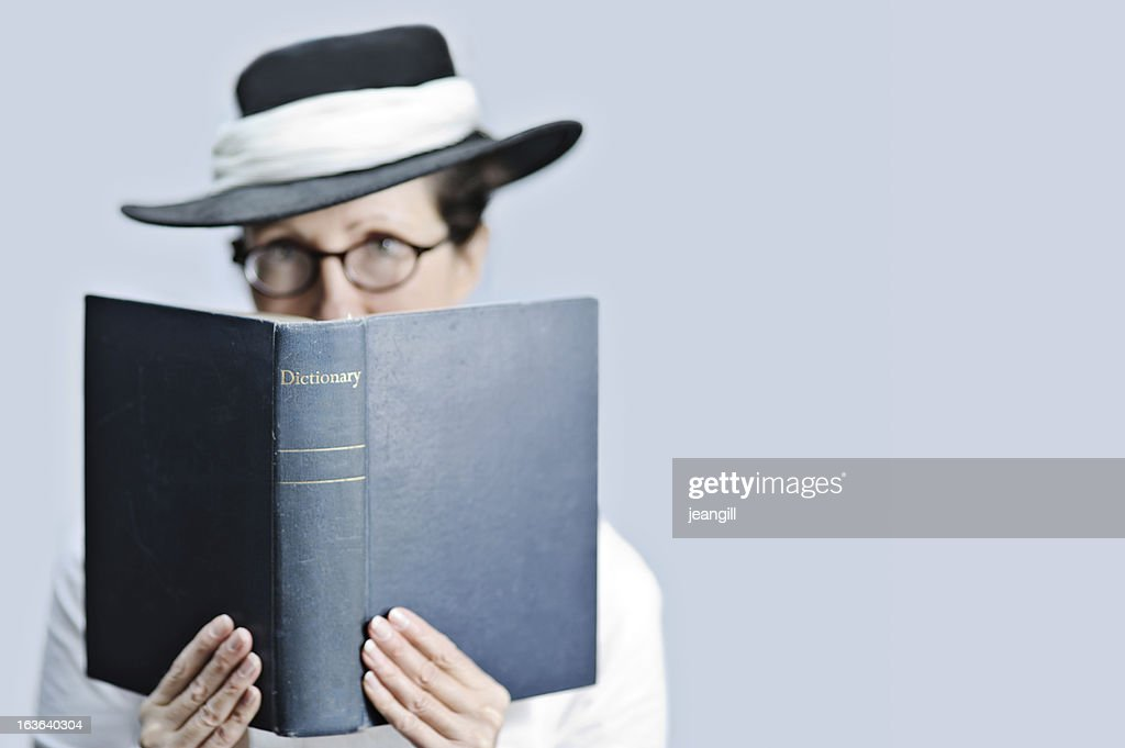 Strict teacher/librarian with dictionary : Stock Photo