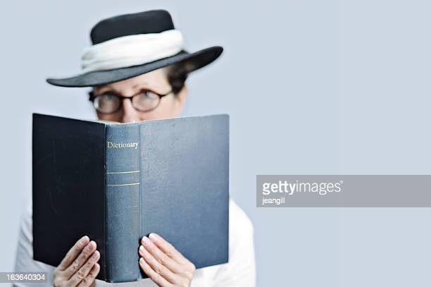 strict teacher/librarian with dictionary - dictionary stock pictures, royalty-free photos & images