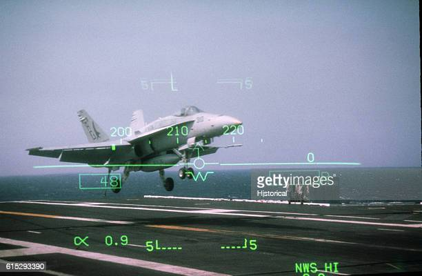 A Strike Fighter Squadron 136 F/A18C Hornet aircraft lands on the flight deck of the nuclearpowered aircraft carrier USS George Washington A cockpit...