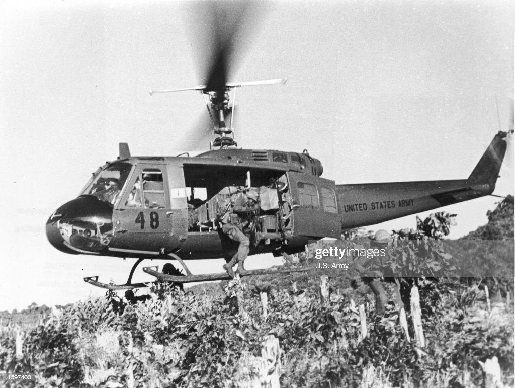 Soldiers jumping from helicopter in air strike vietnam 1967 strike force soldiers of the us army 101st airborne leap from helicopter in an air strike sciox Choice Image