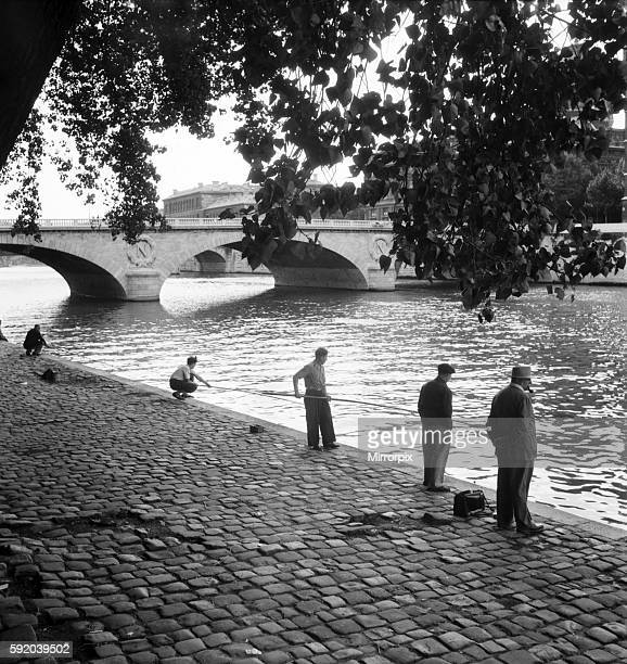 Frenchmen fishing in the River Seine Paris during the general strike August 1953 D5222002