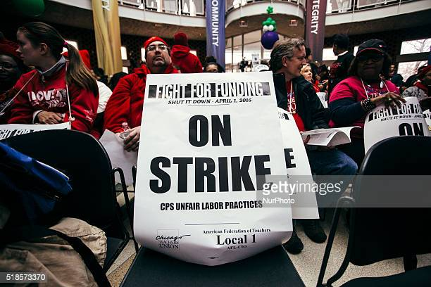 Strike poster left on a chair in the Student Union Building. Teachers gather to protest against education cuts at Chicago State University in...