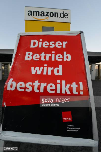 A strike poster reading 'This enterprise is blacked' is set up in front of the logistics center in Bad Hersfeld Germany 16 December 2013 Amazon...