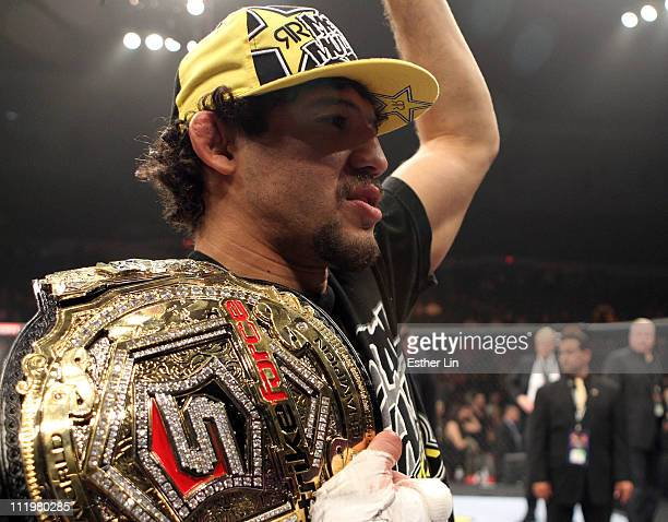 Strikeforce Lightweight Champion Gilbert Melendez celebrates in the cage with his belt after defeating Tatsuya Kawajiri to retain his title at the...