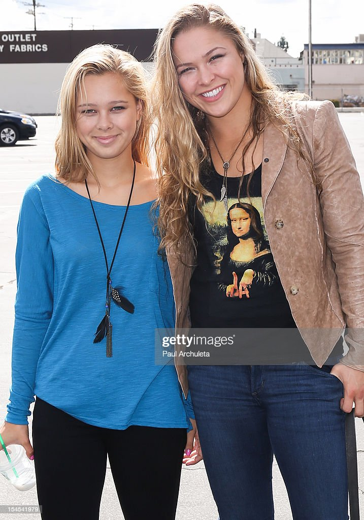 Strikeforce Women's Bantamweight Champion Ronda Rousey (R) and her sister Julia De Mars (L) attend 'A Day Of Champions' benefiting the Bogart Pediatric Cancer Research Program at the Sports Museum of Los Angeles on October 21, 2012 in Los Angeles, California.