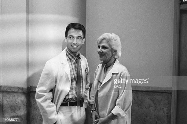 ST ELSEWHERE Strikeout Episode 4 Pictured Mark Harmon as Dr Robert 'Bobby' Caldwell Renee Taylor as Dr Charlotte Miller Photo by Gary Null/NBCU Photo...
