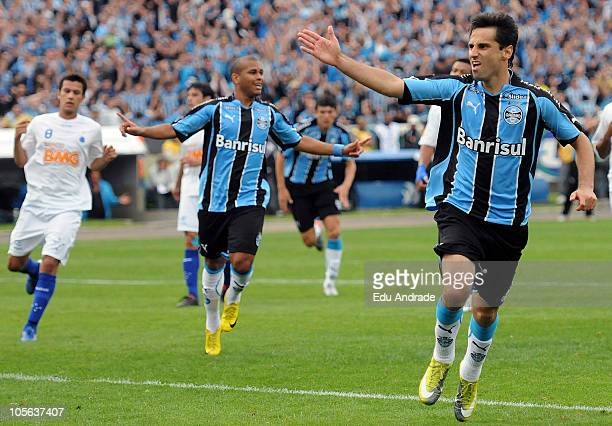 Striker and top scorer Jonas of Gremio celebrates a scored goal during a match against Cruzeiro as part of Serie A at Olimpico stadium on October 17,...
