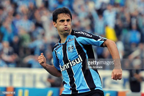 Striker and top scorer Jonas of Gremio celebrates a scored goal during a match against Cruzeiro as part of Serie A at Olimpico stadium on October 17...