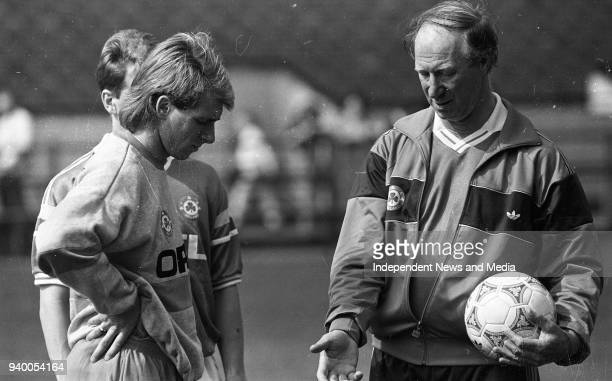 Striker David Kelly gets some advice from Manager Jack Charlton during the Session at Lansdowne Road circa April 1990