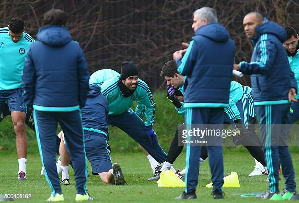 Striker Diego Costa and goalkeeper Thibault Courtois chat during the Chelsea training session at the Chelsea Training Ground on December 8 2015 in...