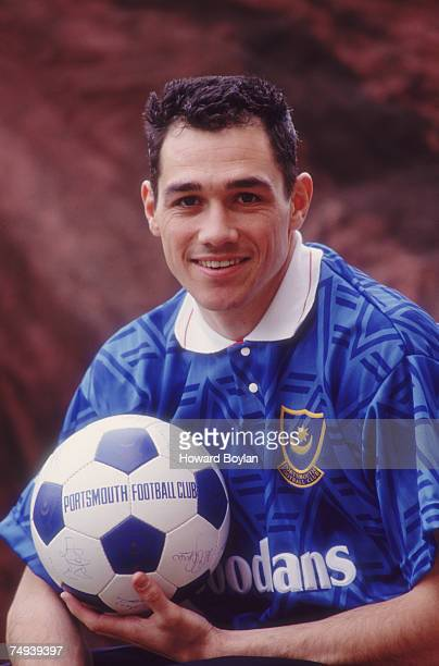 Striker Guy Whittingham wearing his Portsmouth FC kit and holding a football circa 1992