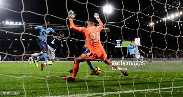 WBA striker Hal Robson Kanu heads the opening goal past Newcastle goalkeeper Karl Darlow during the Premier League match between West Bromwich Albion...