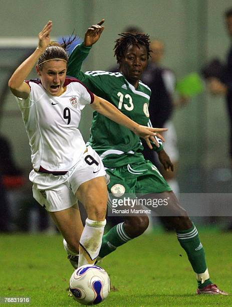 Striker Heather O'Reilly of USA moves the ball against Christie George of Nigeria during the FIFA Women's World Cup 2007 Group B match at Shanghai...