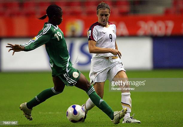 Striker Heather O'Reilly of USA moves the ball against Lilian Cole of Nigeria during the FIFA Women's World Cup 2007 Group B match at Shanghai...