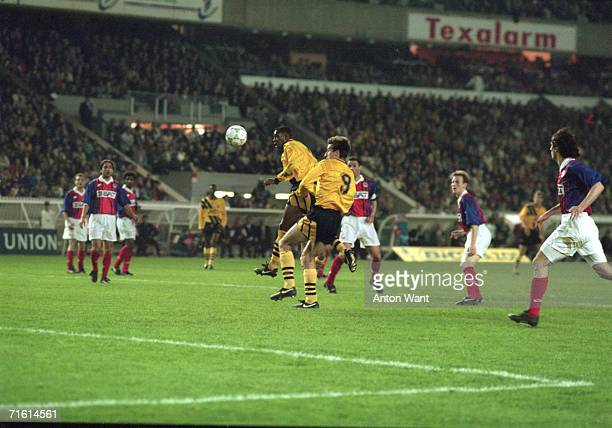 Striker Ian Wright scores during the first leg of the European Cup Winners Cup semi final between Paris Saint Germain and Arsenal at PSG's home...