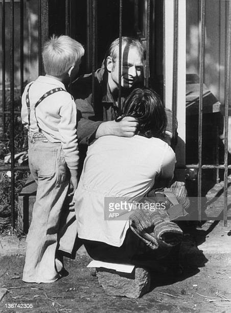 Striker is visited by family members at the gate of the Lenin Shipyard in Gdansk where some 17 000 workers staged a strike and barricaded themselves...