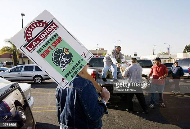 A striker pickets urging shoppers to avoid Vons Pavilions and Albertsons supermarkets as International Longshore and Warehouse Union members deliver...