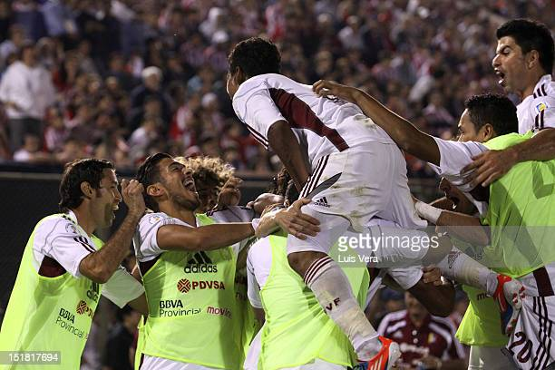 Striker Salomon Rondon of Venezuela celebrates a goal with his teammates during a after the match from Paraguay and Venezuela as part of the South...