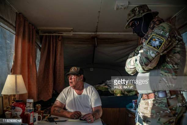 Striker the leader of the Constitutional Patriots New Mexico Border Ops Team militia speaks with Viper who go by aliases to protect their identity...