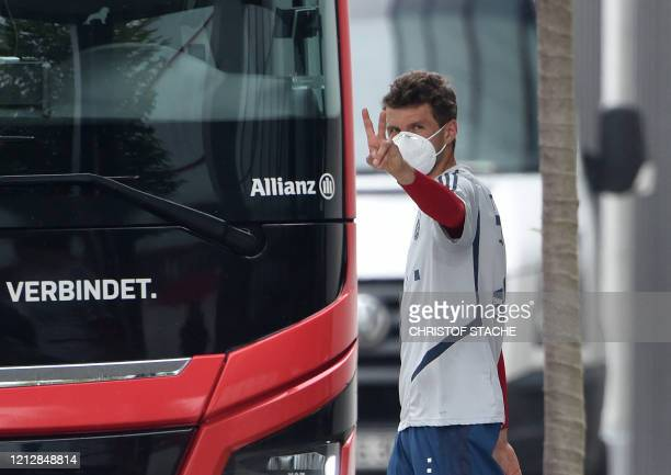 Striker Thomas Mueller wears a face mask as he leaves after a training session of the German first division Bundesliga football club FC Bayern Munich...
